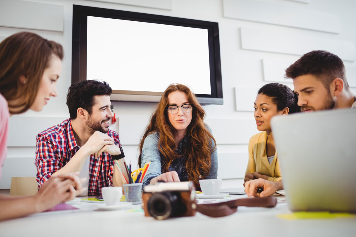 three women and two men in a team meeting